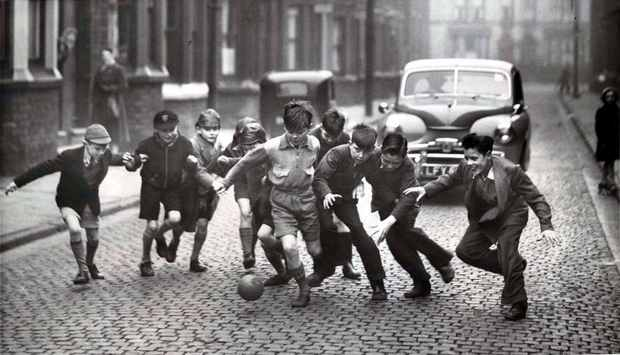 Heritage - Children play football in a street in Everton 21 January 1956