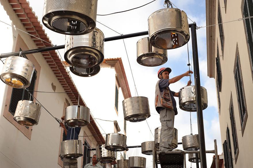 We-put-133-old-washing-machine-drums-to-illuminate-the-street-576a7b631fb6c__880